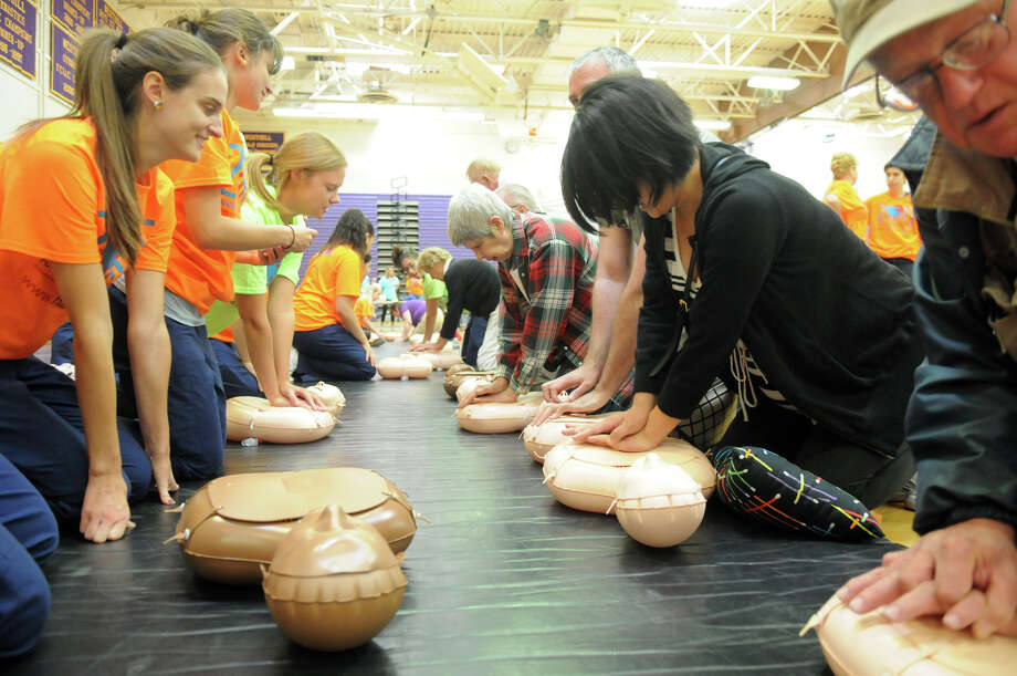 Hands for Life Stamford races toward its goal of training 10,000 people how to do CPR with training en masse at Westhill High School in Stamford, Conn., Sept. 26, 2015. By Friday, the effort, forged by the City of Stamford and including with Darien, New Canaan, Greenwich and other local communities into the effort, had already trained 8,500 people. Developed in 2009, Hands for Life is a free CPR training event. Photo: Keelin Daly / For Hearst Connecticut Media / Keelin Daly