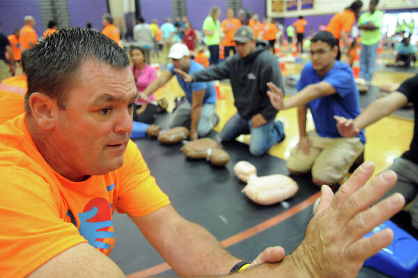 The City of Stamford's Ron Markey trains a group as Hands for Life Stamford races toward its goal of training 10,000 people how to do CPR with training en masse at Westhill High School in Stamford, Conn., Sept. 26, 2015. By Friday, the effort, forged by the City of Stamford and including with Darien, New Canaan, Greenwich and other local communities into the effort, had already trained 8,500 people. Developed in 2009, Hands for Life is a free CPR training event.