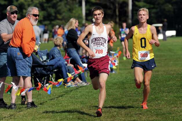Kingston's Thorr Trowbridge, center, and Queensbury's Ethan Carey, right, come in third and fourth, respectively, in the Division 1 boys' race during the Queensbury Invitational cross country meet on Saturday, Sept. 26, 2015, at Queensbury High in Queensbury, N.Y. (Cindy Schultz / Times Union) Photo: Cindy Schultz / 10033478A