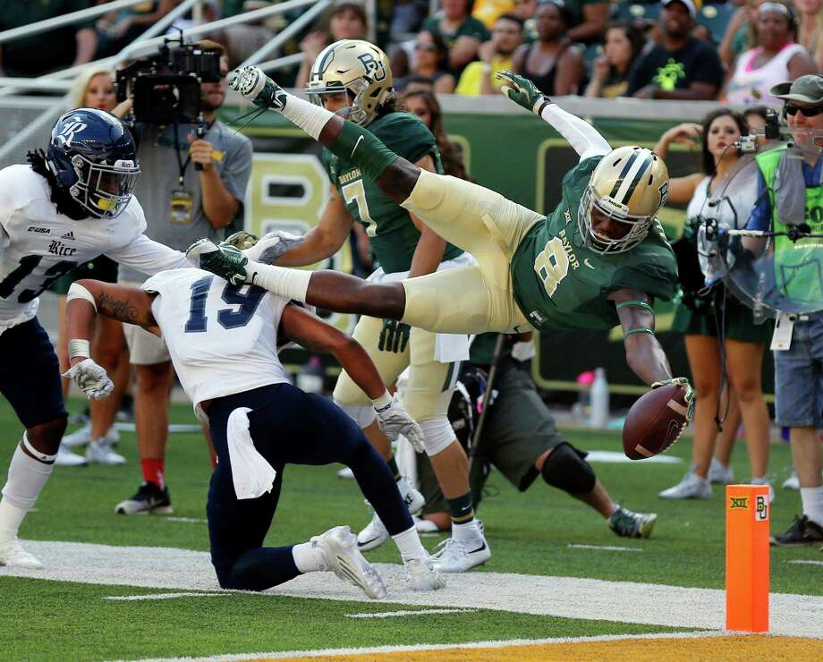 Baylor wide receiver Ishmael Zamora (8) scores over Rice safety VJ Banks (19),  in the second half of an NCAA college football game, Saturday, Sept. 26, 2015, in Waco, Texas. (AP Photo/Rod Aydelotte) Photo: Rod Aydelotte, Associated Press / FRE36102AP
