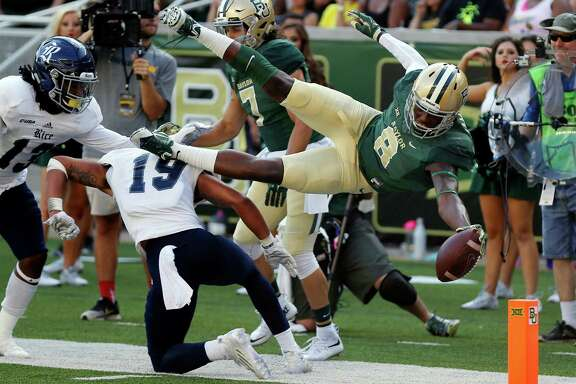 Baylor wide receiver Ishmael Zamora (8) scores over Rice safety VJ Banks (19),  in the second half of an NCAA college football game, Saturday, Sept. 26, 2015, in Waco, Texas. (AP Photo/Rod Aydelotte)