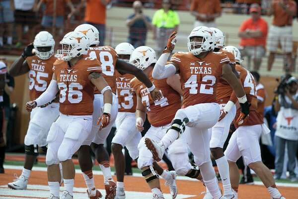 Texas celebrates a touchdown by Tyrone Swoopes against Oklahoma State during the first half at Royal-Memorial Stadium in Austin, Texas, on Saturday Sept. 26, 2015. Oklahoma State won, 30-27. (Deborah Cannon/Austin American-Statesman/TNS)