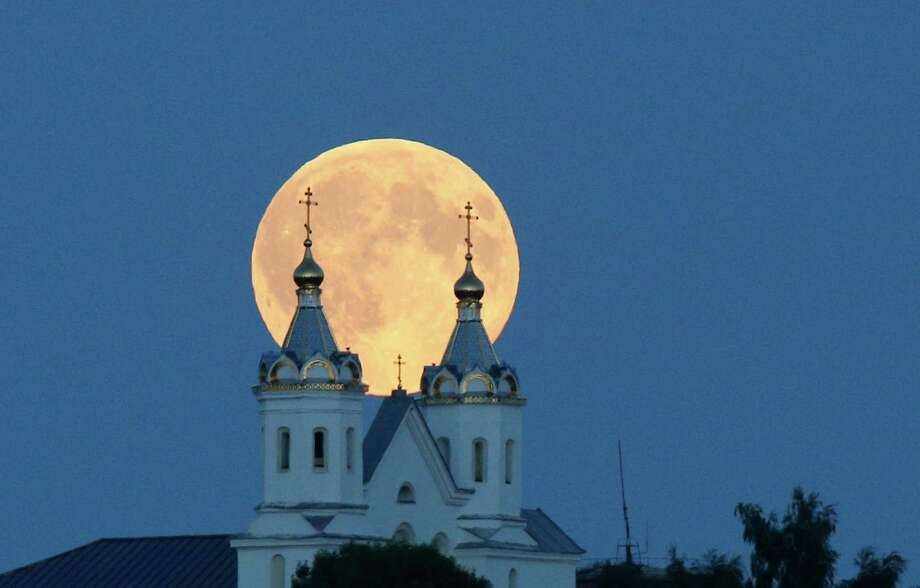 A supermoon occurs when the moon is full and makes it closest approach to Earth in her orbit. Head outside Sunday night or early Monday morning, depending on your location, and turn your eyes east - you'll glimpse the rare combination of a supermoon and lunar eclipse.    Photo: Sergei Grits, STF / AP