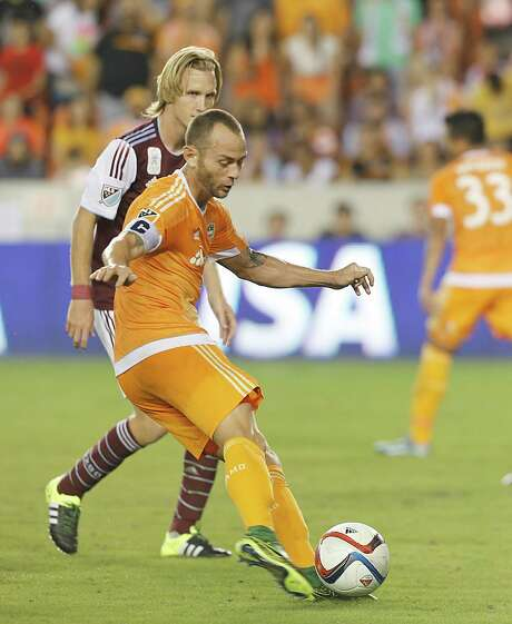 Midfielder Brad Davis, foreground, scored the game-winning goal in the 47th minute as the Dynamo beat the Colorado Rapids on Saturday at BBVA Compass Stadium to remain in the picture for a berth in the MLS playoffs. Photo: Thomas B. Shea, For The Chronicle / © 2015 Thomas B. Shea