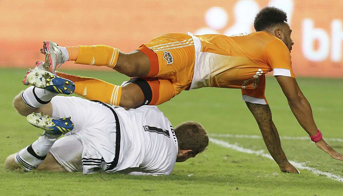 Houston Dynamo goalkeeper Tyler Deric (1) scores and trips over Colorado Rapids goalkeeper Clint Irwin (1) in the first half on Saturday, September 26, 2015 at BBVA Compass Stadium in Houston, TX.