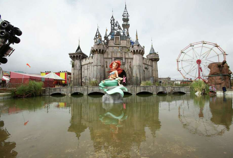 "Street artist Banksy's ""bemusement park"" has revitalized British seaside town Weston-super-Mare. Photo: Yui Mok, SUB / PA"