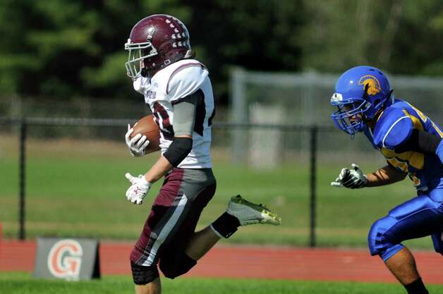Burnt Hills' Joshua Craig, left, outruns Queensbury's Patrick Conway for a touchdown during their football game on Saturday, Sept. 26, 2015, at Queensbury High in Queensbury, N.Y. (Cindy Schultz / Times Union) Photo: Cindy Schultz / 10033493A