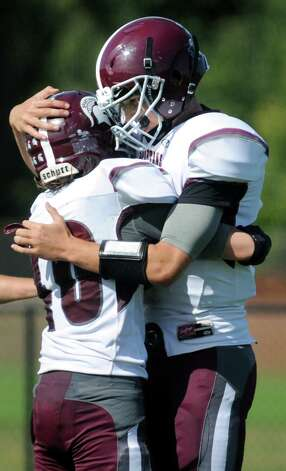 Burnt Hills' Joshua Craig, left, embraces quarterback John Clayton as they celebrate Craig's touchdown during their football game on Saturday, Sept. 26, 2015, at Queensbury High in Queensbury, N.Y. (Cindy Schultz / Times Union) Photo: Cindy Schultz / 10033493A