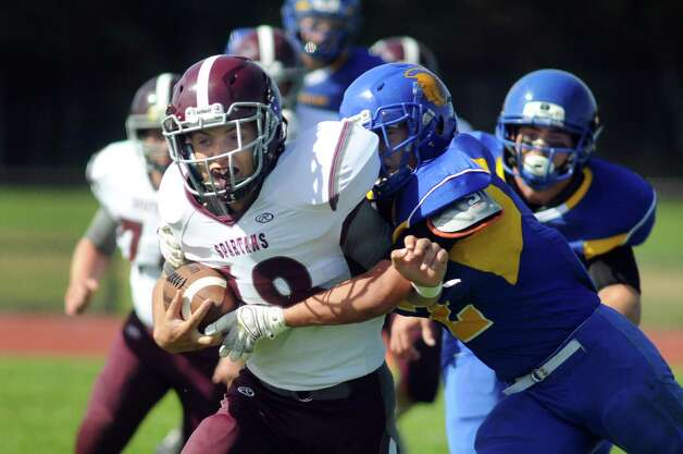 Burnt Hills' Joseph Braun, left, carries the ball as Queensbury's Jared Bruno defends during their football game on Saturday, Sept. 26, 2015, at Queensbury High in Queensbury, N.Y. (Cindy Schultz / Times Union) Photo: Cindy Schultz / 10033493A