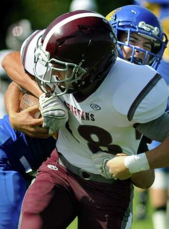 Queensbury's Jared Bruno, right, tries to strip the ball as Burnt Hills' Joseph Braun hangs on during their football game on Saturday, Sept. 26, 2015, at Queensbury High in Queensbury, N.Y. (Cindy Schultz / Times Union) Photo: Cindy Schultz / 10033493A