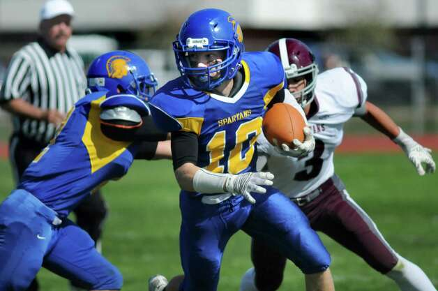 Queensbury's quarterback Kevin Collins, center, looks for room to run during their football game against Burnt Hills on Saturday, Sept. 26, 2015, at Queensbury High in Queensbury, N.Y. (Cindy Schultz / Times Union) Photo: Cindy Schultz / 10033493A