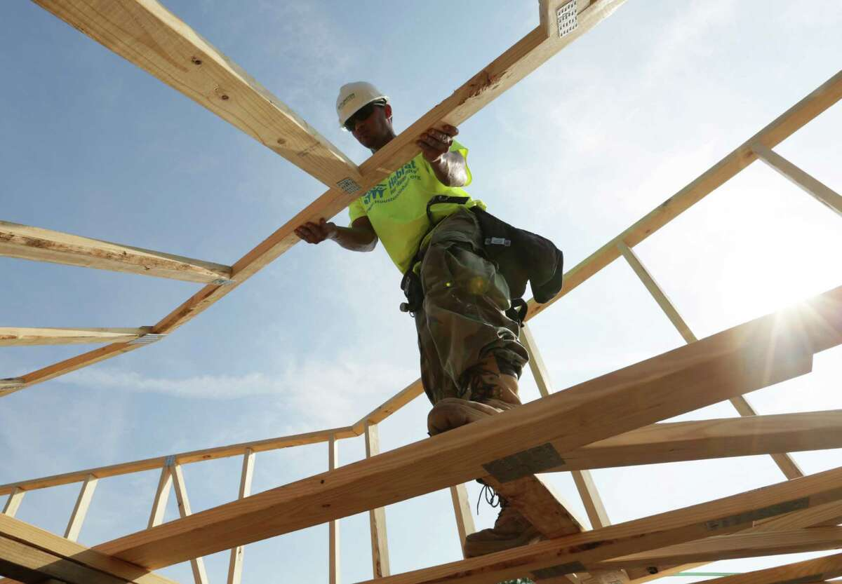 Build Help build a house with Houston's Habitat for Humanity.