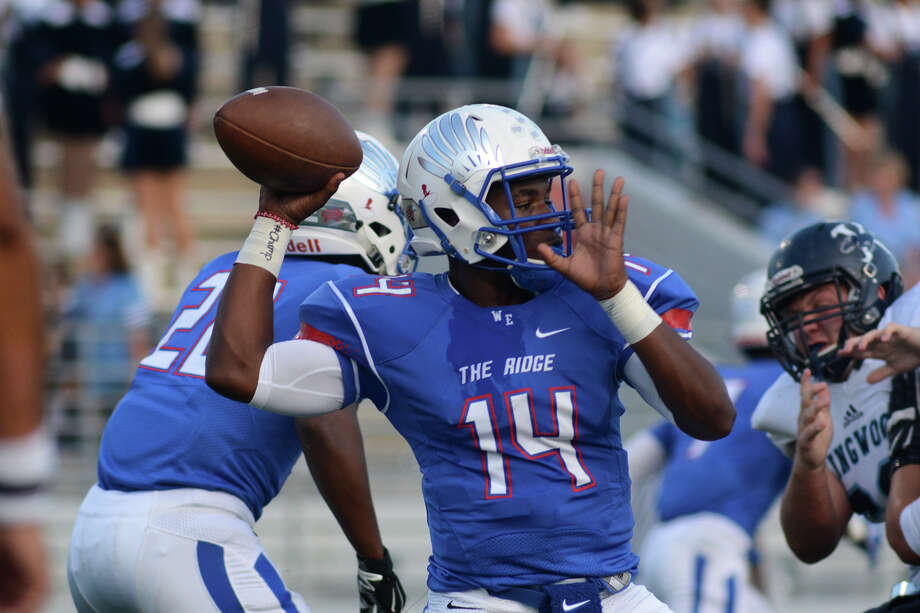 Oak Ridge sophomore quarterback Bishop Durst (14) targets a receiver against the Kingwood defense during 1st quarter action of their District 16-6A matchup at Woodforest Bank Stadium on Saturday, Sept. 26, 2015. (Photo by Jerry Baker/Freelance) Photo: Jerry Baker, For The Houston Chronicle