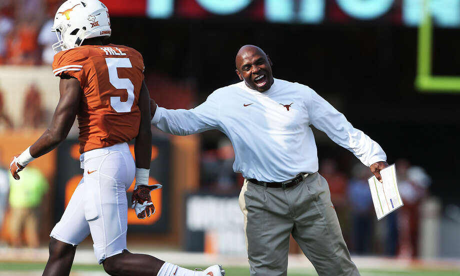 Longhorns coach Charlie Strong congratulates defensive back Holton Hill on a touchdown after an interception as Texas hosts Oklahoma State at Royal-Memorial Stadium on Sept. 26, 2015. Photo: Tom Reel /San Antonio Express-News / San Antonio Express-News