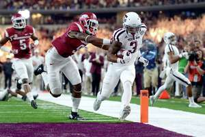 Texas A&M's Christian Kirk (3) is pushed out of the end zone after crossing the goal line for a touchdown, by Arkansas' Santos Ramirez (9), during the first half of an NCAA college football game Saturday, Sept. 26, 2015, in Arlington, Texas. (Sam Craft/The Bryan-College Station Eagle via AP)
