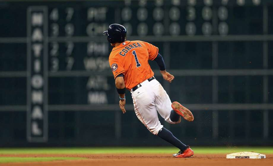 Carlos Correa rounds second base in Saturday's seventh inning after hitting his 21st homer, tying the Astros rookie record set by Lance Berkman in 2000. Photo: Karen Warren, Staff / © 2015 Houston Chronicle