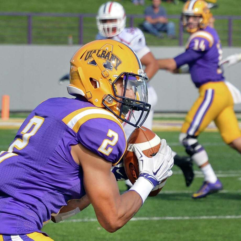 UAlbany's #2 Josh Gontarek, left catches a DJ Crook, right,  pass during Saturday's game against Duquesne at Bob Ford Field Sept. 26, 2015 in Albany, NY.  (John Carl D'Annibale / Times Union) Photo: John Carl D'Annibale / 00033508A
