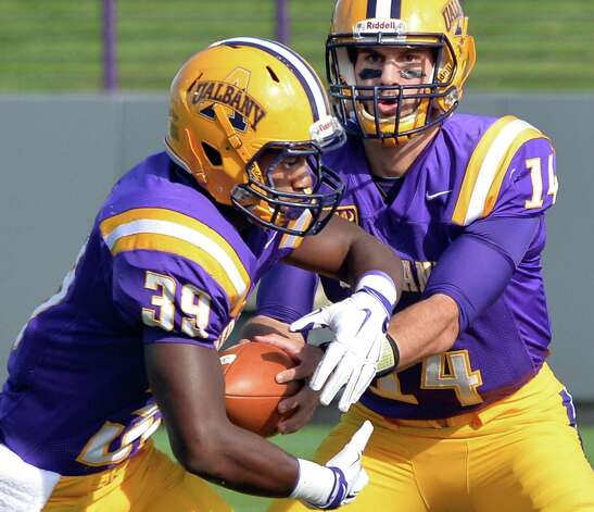 UAlbany QB #14 DJ Crook hands off to #39 Elliot Croskey during Saturday's game against Duquesne at Bob Ford Field Sept. 26, 2015 in Albany, NY.  (John Carl D'Annibale / Times Union) Photo: John Carl D'Annibale / 00033508A