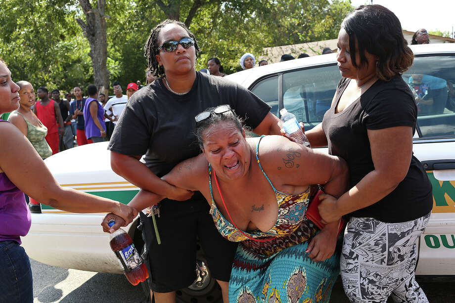 People support Olivia Fenner, the mother of Tru Trusty, 16, who friends and family said was killed in a drive-by shooting in the 700 block of Sterling Street on the East Side. Photo: Lisa Krantz /San Antonio Express-News / ©2015 San Antonio Express-News