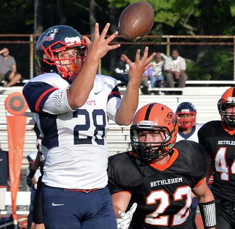 Schenectady High's #28 Kyle Bacon catches a Nate Scheider pass as Bethlehem's #22 Steve Mendleson covers during Saturday's game Sept. 26, 2015 in Bethlehem,NY.  (John Carl D'Annibale / Times Union) Photo: John Carl D'Annibale / 00033505B