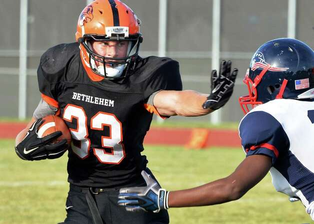 Bethlehem's #33 Ben Tietjen, left, fends off a tackle by Schenectady's #38 Elijah Marshall during Saturday's game Sept. 26, 2015 in Bethlehem,NY.  (John Carl D'Annibale / Times Union) Photo: John Carl D'Annibale / 00033505B