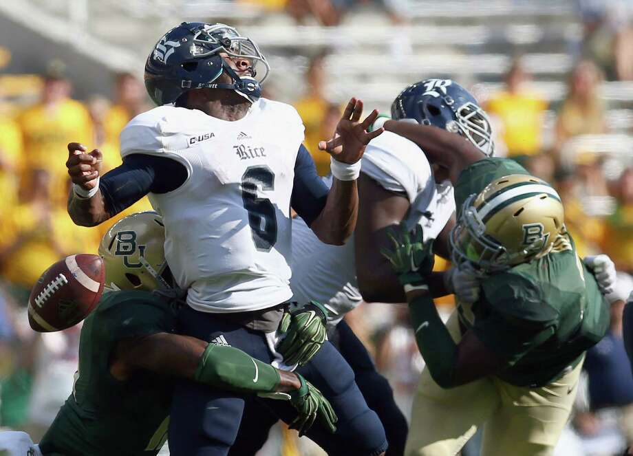 Rice quarterback Driphus Jackson loses the football as he is crunched from behind by Baylor's Brian Nance. Driphus was 10-for-17 passing for 115 yards. Photo: Tom Pennington, Staff / 2015 Getty Images