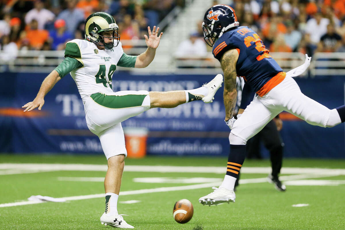 UTSA's Justin Chavez (right) blocks a punt by Colorado State's Hayden Hunt during the first half at the Alamodome on Sept. 26, 2015.