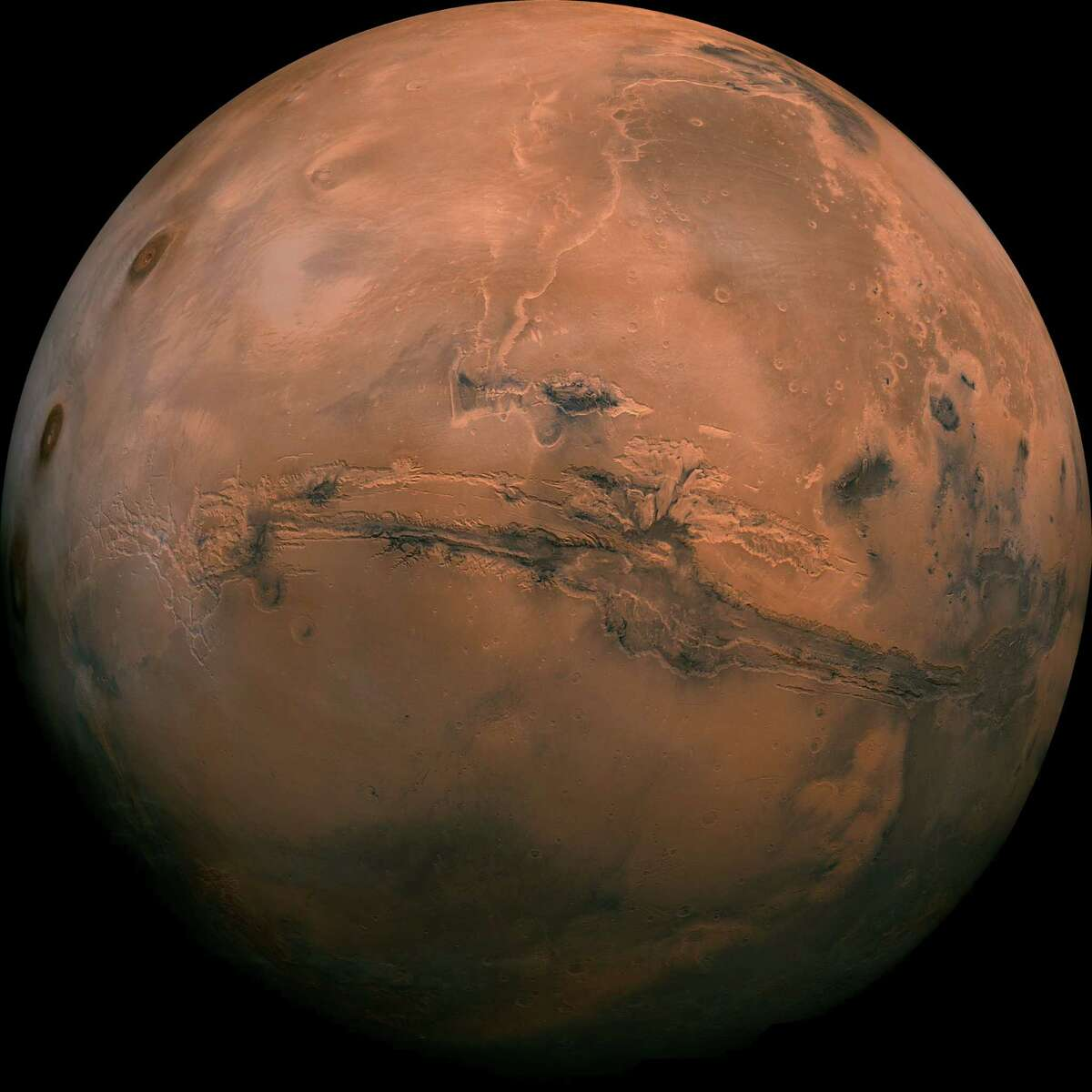 Mosaic of the Valles Marineris hemisphere of Mars projected into point perspective, a view similar to that which one would see from a spacecraft. See more amazing images from the red planet.