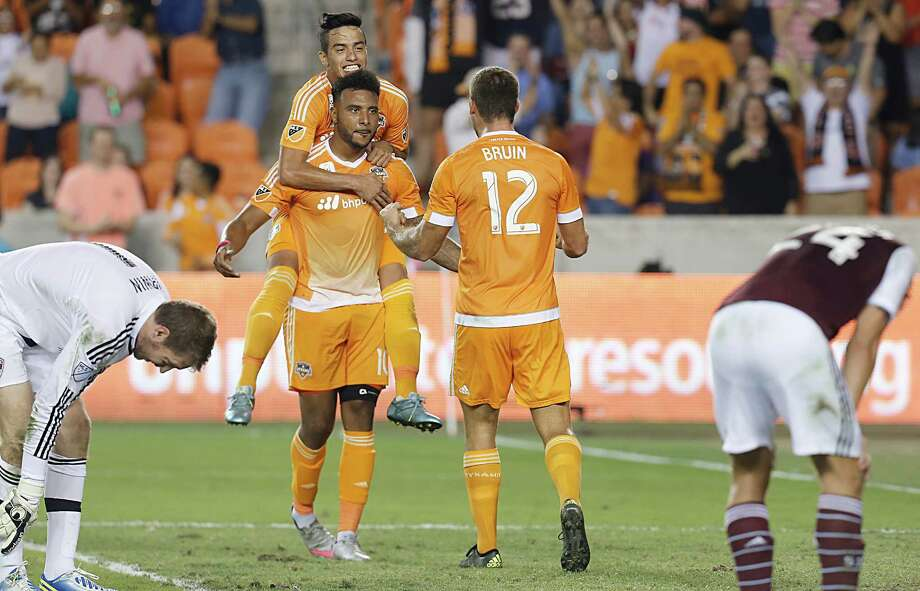 Dynamo forward Will Bruin (12) celebrates teammate Giles Barnes' goal against the Colorado Rapids in the first half Saturday night at BBVA Compass Stadium. Barnes, center, assisted on the Dynamo's first goal by Leonel Miranda in the first half. Brad Davis' fourth goal of the season won the match. Photo: Thomas B. Shea, Freelance / © 2015 Thomas B. Shea