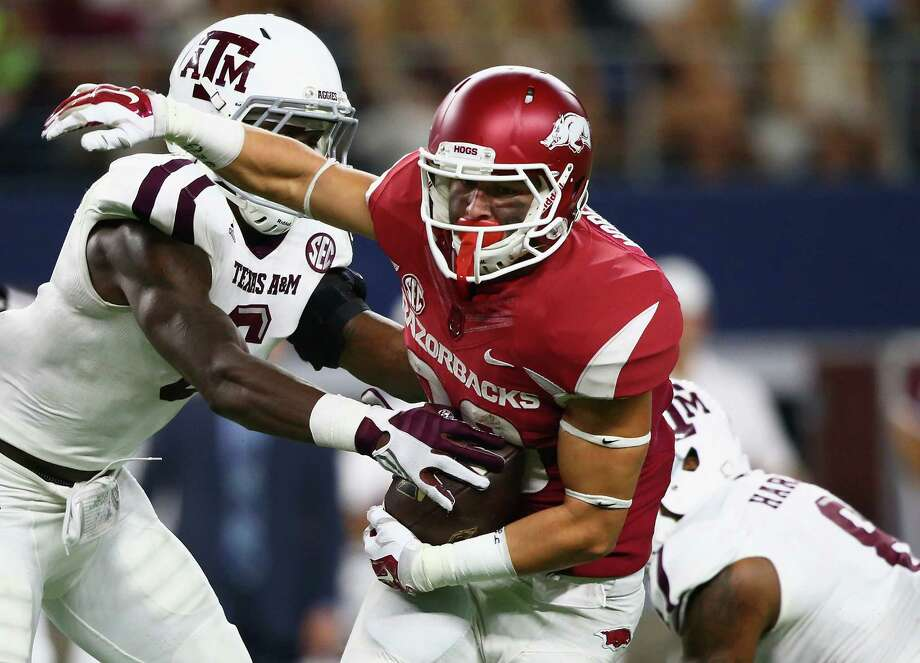 Drew Morgan of the Arkansas Razorbacks runs the ball against the Texas A&M Aggies at AT&T Stadium on Sept. 26, 2015 in Arlington, Texas. Photo: Ronald Martinez /Getty Images / 2015 Getty Images