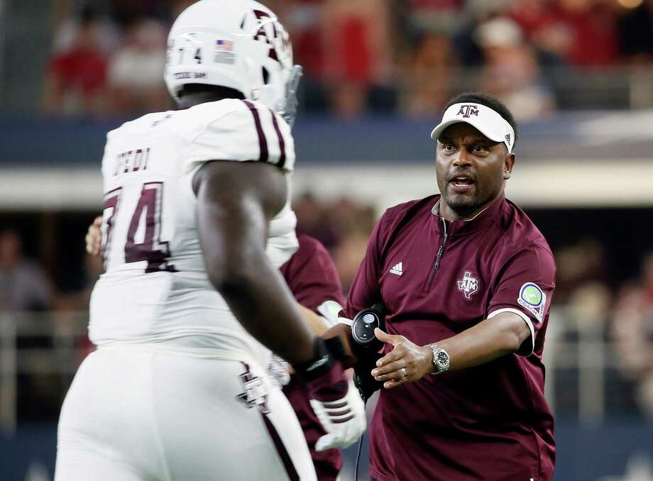 Texas A&M offensive lineman Germain Ifedi (74) is greeted by coach Kevin Sumlin as he jogs off the field during the first half against Arkansas on Sept. 26, 2015, in Arlington. Photo: Tony Gutierrez /Associated Press / AP