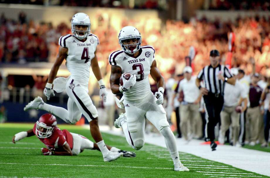 Texas A&M's Christian Kirk (3) runs down the sideline before scoring a touchdown against Arkansas during the first half on Sept. 26, 2015, in Arlington. Photo: Sam Craft /Bryan-College Station Eagle / The Bryan-College Station Eagle