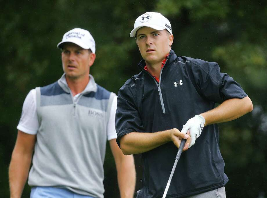 Jordan Spieth, right, watches his drive on the 3rd tee with Henrik Stenson looking on in the third round of the Tour Championship at East Lake Golf Club in Atlanta on Saturday, Sept. 26, 2015. (Curtis Compton/Atlanta Journal-Constitution/TNS) Photo: Curtis Compton, MBR / Atlanta Journal-Constitution