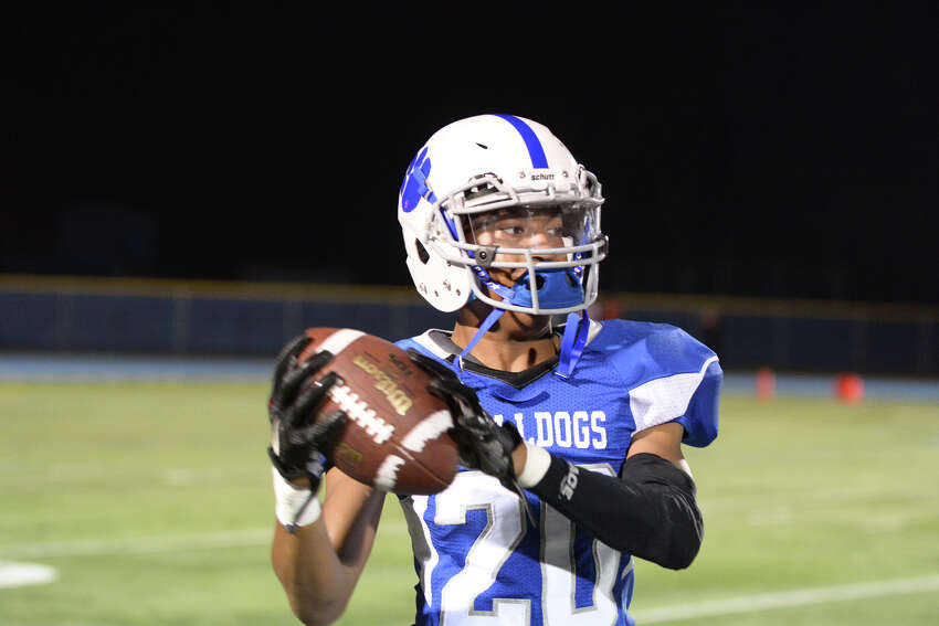 10. Slippery pigskin: With a torrential rain falling Friday night across the region nobody has more trouble holding onto the ball than Weston which fumbled seven times, losing five as Bunnell capitalized, beating the Trojans 34-14. (File photo)