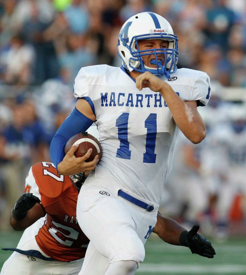 A bomb to MacArthur's Zach Pastor set up their first TD in first quarter against Madison.  District 26-6A high school football game between MacArthur and Madison at Comalander Stadium on Saturday, September 26,2015 Photo: Ron Cortes, Freelance / For The San Antonio