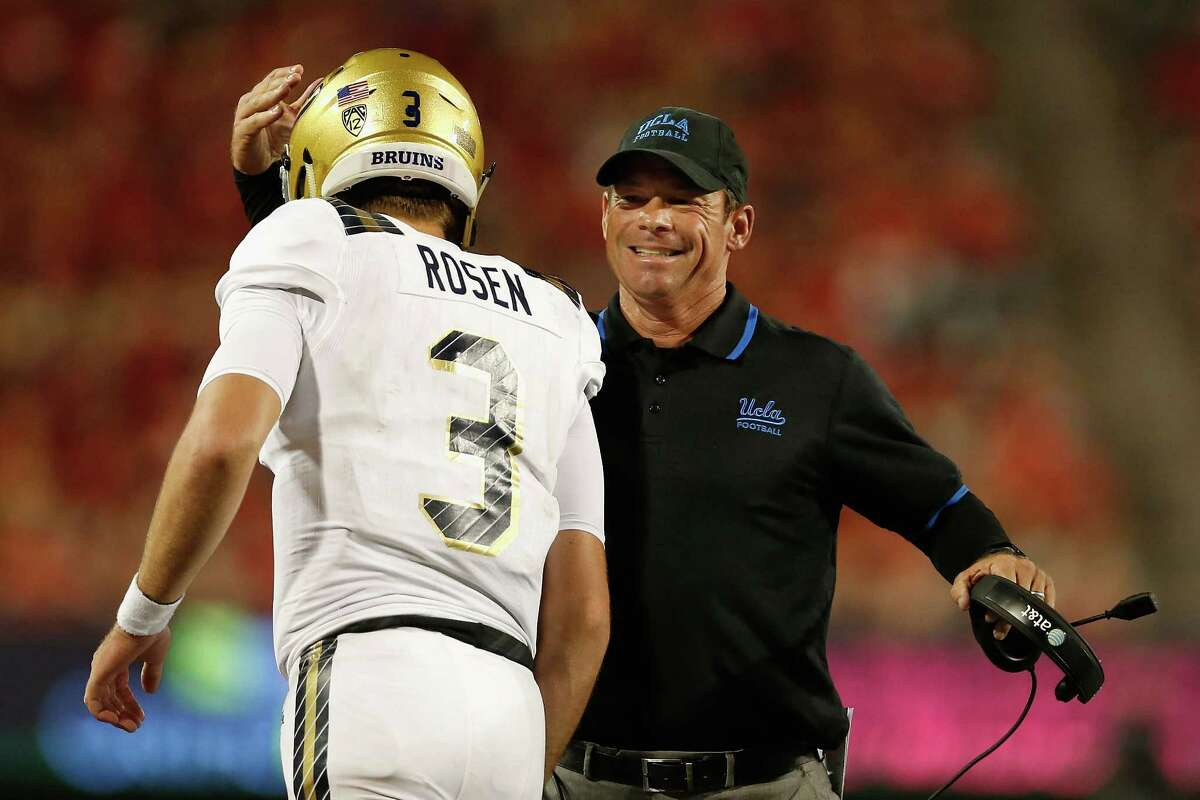 TUCSON, AZ - SEPTEMBER 26: Head coach Jim Mora of the UCLA Bruins congratulates quarterback Josh Rosen #3 after Rosen scored on a eighth yard rushing touchdown against the Arizona Wildcats during the thrid quarter of the college football game at Arizona Stadium on September 26, 2015 in Tucson, Arizona. The Bruins defeated the Wildcats 56-23. (Photo by Christian Petersen/Getty Images)
