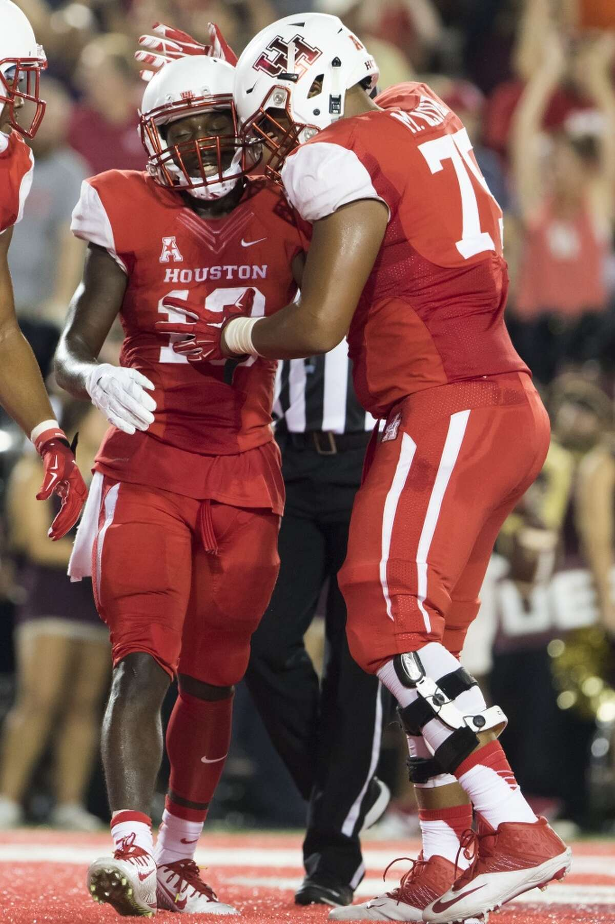 Houston Cougars' wide receiver Demarcus Ayers (10) celebrates with offensive lineman Marcus Oliver (75) after catching a touchdown in the second quarter of a NCAA college football game at TDECU Stadium on Saturday, September 26, 2015, in Houston. ( Joe Buvid / For the Chronicle )