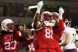 Houston Cougars' linebacker Tyus Bowser (81) celebrates after sacking Texas State Bobcats quarterback Tyler Jones in the first quarter of a NCAA college football game at TDECU Stadium on Saturday, September 26, 2015, in Houston.