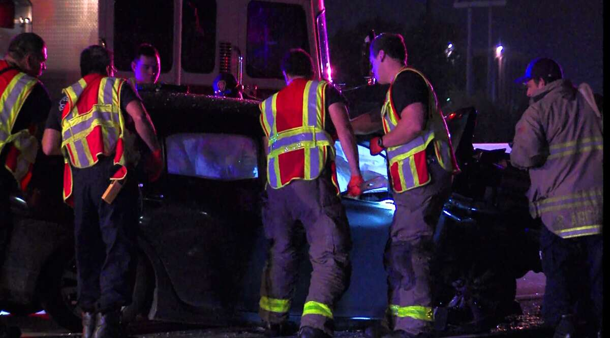 San Antonio police and firefighters respond to a wreck on the North Side where two women died following a head-on collision with a guardrail on Loop 410 early Sunday, Sept. 26, 2015.