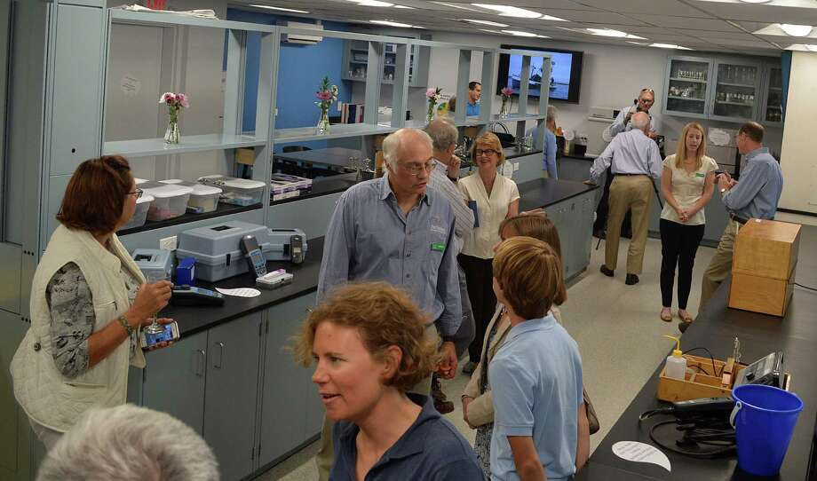 Visitors to Harbor Watch's new Richard Harris Laboratory at Earplace check out the facilities after the dedication ceremony. Photo: Jarret Liotta / For Hearst Connecticut Media / Westport News
