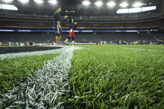Houston Texans quarterback Ryan Mallett warms up on the newly-installed AstroTurf before an NFL football game against the Tampa Bay Buccaneers at NRG Stadium on Sunday, Sept. 27, 2015, in Houston. It is the first game the Texans will play a regular season game at home on an artificial surface. ( Brett Coomer / Houston Chronicle )