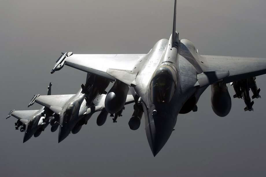 A French military photo shows Rafale fighter jets flying toward Syria and an Islamic State target. Photo: -, AFP / Getty Images