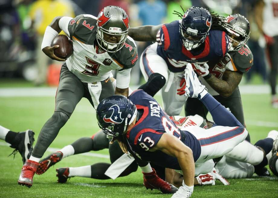 Jared Crick (93), Jadeveon Clowney and the rest of the Texans' defense held Jameis Winston and Tampa Bay to just nine points Sunday in picking up their first win of the 2015 season. Photo: Brett Coomer, Houston Chronicle