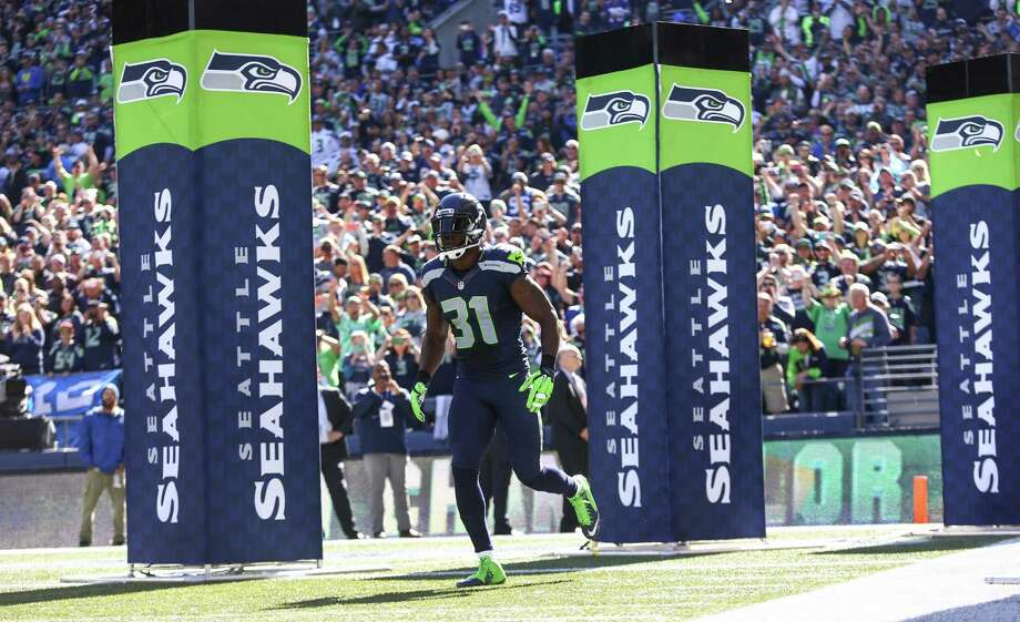 Seattle Seahawks strong safety Kam Chancellor runs onto the field for pregame introductions ahead of Seattle's game with the Chicago Bears at CenturyLinkField on September 27, 2015. Photo: Seattlepi.com