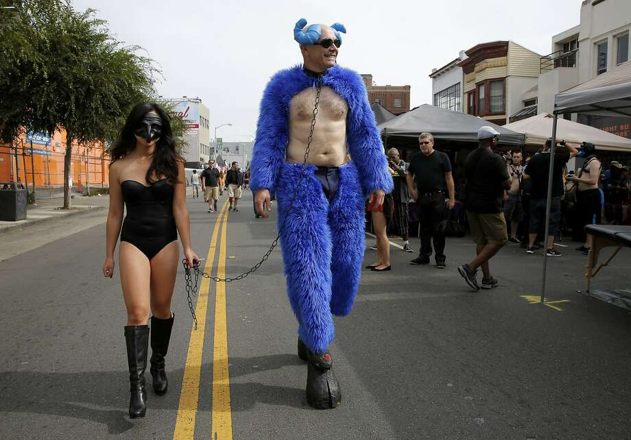 The Folsom Street Fair takes over SoMa on Sunday, Sept. 25. The annual celebration of leather, fetish and BDSM communities brings hundreds of thousands of people to SoMa. Click through to take a look at highlights from years past.A couple at the Folsom Street Fair in San Francisco, California, on Sunday, Sept. 27, 2015. Photo: Connor Radnovich, The Chronicle