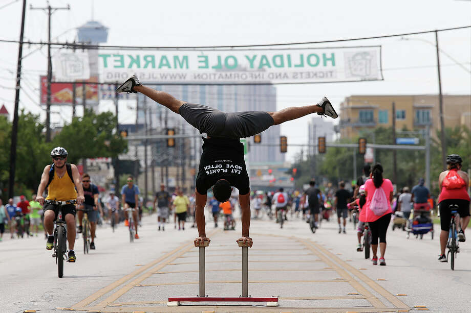 Amos Lozano works on his balancing skills along Broadway Street during the YMCA of Greater San Antonio Siclovia, Sunday, Sept. 27, 2015. The event is free to the public and a 3.25 miles stretch of Broadway from downtown to Lion's Park is closed to traffics so that the people can walk, run, bike and enjoy the area. Also included in the event  Dignowity Park on the near eastside. Photo: JERRY LARA, San Antonio Express-News / © 2015 San Antonio Express-News