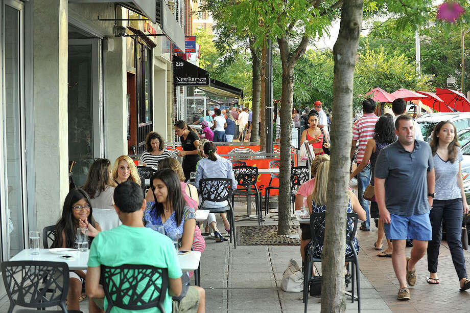 Diners sit on the sidewalk in front of various restaurants along Bedford Street in Stamford during the summer. City lawmakers are considering an increase in fees charged to restaurants for outdoor dining. Photo: Jason Rearick / Hearst Connecticut Media / Stamford Advocate