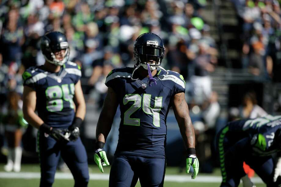 Seattle Seahawks running back Marshawn Lynch (24) stands on the field after a play against the Chicago Bears in the first half of an NFL football game, Sunday, Sept. 27, 2015, in Seattle. (AP Photo/Elaine Thompson) Photo: Elaine Thompson, Associated Press / AP