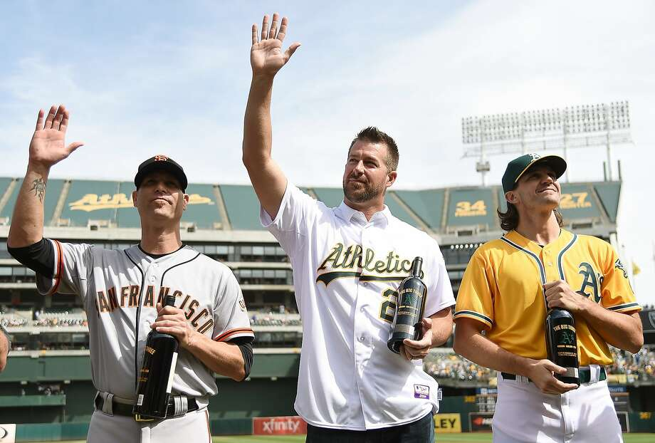 OAKLAND, CA - SEPTEMBER 27:  The Big Three, Barry Zito #75 of the Oakland Athletics (R), former Oakland Athletics Mark Mulder #20 (C) and Tim Hudson #17 of the San Francisco Giants (L) is presented with a bottle of chardonnay wine by the the Oakland Athletics prior to the game at O.co Coliseum on September 27, 2015 in Oakland, California. Zito, Hudson, and Mulders were teammates with the Athletics from 2000-2004. (Photo by Thearon W. Henderson/Getty Images) Photo: Thearon W. Henderson, Getty Images
