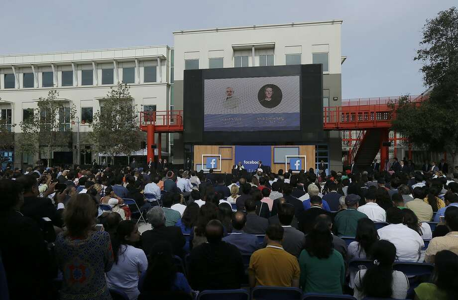 A crowd listens as Prime Minister of India Narendra Modi and Facebook CEO Mark Zuckerberg hold a town hall meeting at Facebook in Menlo Park. Photo: Jeff Chiu, Associated Press